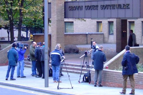 The press gather outside the court