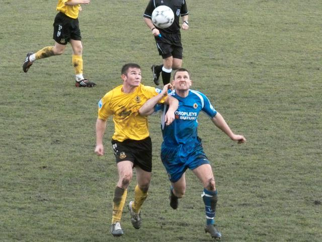 Talbot battles for the ball
